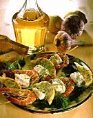 Sea devil and shrimp kebabs with lemon slices