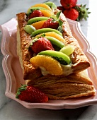 Puff pastry slice with cream filling and fresh fruit