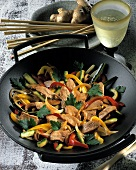 Finely chopped chicken with vegetables & ginger in wok