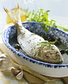Bream with herbs with black olives and garlic