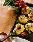 Oven-baked noodle nests au gratin