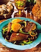 Chinese pork ribs on peppers with oranges