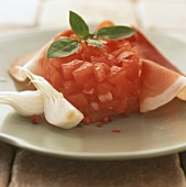 Chopped tomato timbale with ham and onions