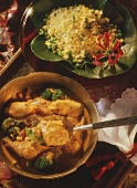 Saffron rice with peas & chicken curry with broccoli