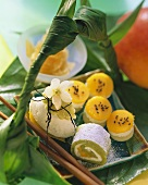Various marzipan sushi with kiwi fruit and mango