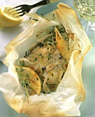 Halibut cutlets in baking parchment with thyme & olives