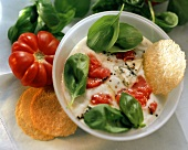 Cream cheese soup with cream gorgonzola & tomato pieces