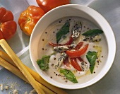 Creamed cheese soup with gorgonzola cream & tomato pieces
