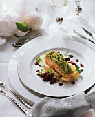 Salmon with savoy & potato crust on ribbon noodles