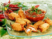 Chili stuffed with cheese in tempura batter, onion ketchup