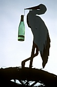 A stork with a wine bottle (Alsace, France)