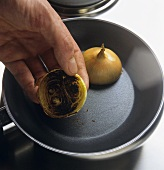 Frying halved onions in the frying pan
