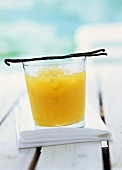 Mango drink with crushed ice and vanilla pods