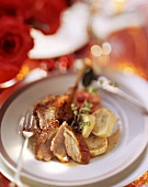 Duck with baked apple and dumpling slices