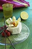 Quark dessert, garnished with raspberries & physalis