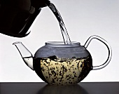 Pouring boiling water over the tea leaves