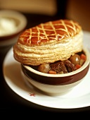 Beef stew with puff pastry topping