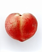 A heart-shaped peach