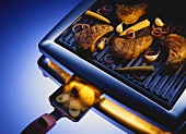 Meat and vegetables on raclette grill