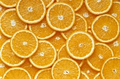 Many orange slices (filling the picture)