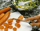 Slicing carrots with garnishing knife
