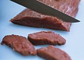 Cutting ostrich meat
