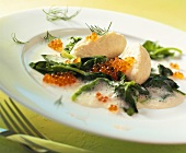 Pike dumplings with caviare on spinach