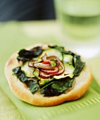 Mini-pizza with spinach and courgette