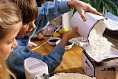 Children weighing flour for baking