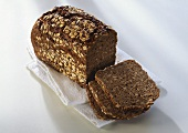 Wholemeal bread, loaf and three slices
