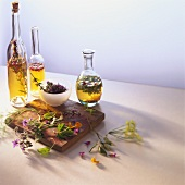 Still life with various types of vinegar & herbs