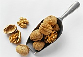 Walnuts on and beside a scoop