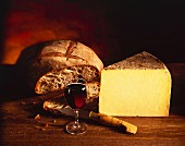 Still life with Cantal cheese, bread and red wine