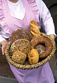 Woman Holding Baked Breads