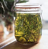 Rosemary oil in a preserving jar