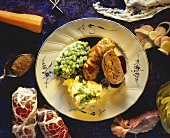 Beef roulade in pork caul with mashed potato and peas