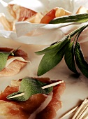 Raw veal escalope with sage and ham (saltimbocca)