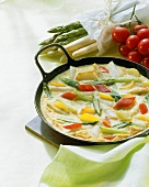 Asparagus frittata with potatoes and peppers