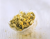 Dried camomile flowers in muslin net