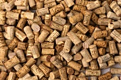 Many different wine corks, covering the surface