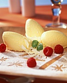 White mousse au chocolat, decoration: raspberries & icing sugar