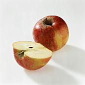 Whole and half apple (Cox's Orange Pippin)
