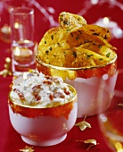 Herbed potato crisps and yoghurt and tomato dip in bowls