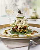 Salad tower: vegetables, sole, crème fraiche and caviare