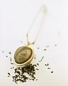 Tea tongs with tea leaves