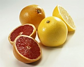 Pink and yellow grapefruit, whole and cut open