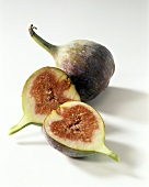 Halved and whole fig