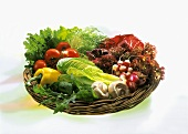 Various vegetables in shallow wicker bowl