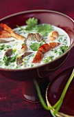 Thai coconut soup with shrimps, beef and coriander