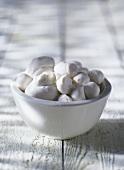 Several mozzarellas in a white bowl